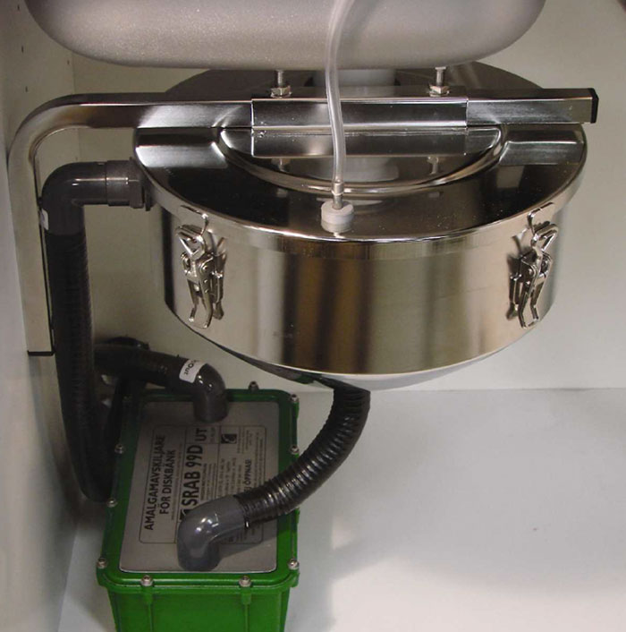 Amalgam separators (pictured) can be easily attached to dental chairs to capture waste mercury, keeping it out of waterways.